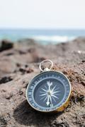 Compass and ocean - orientation concept Stock Photos