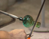 Stock Video Footage of Glass blower decorating a roman bottle