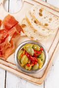 Platter of serrano jamon Cured Meat, Ciabatta, chorizo and olive - stock photo