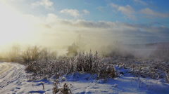 Frosty sunset above field at winter day Stock Footage