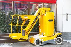 Yellow hydraulic lift platform mobile utility vehile Stock Photos