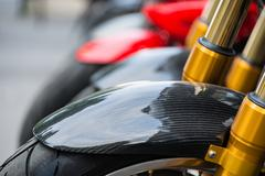 Carbon fiber motorbike closeup - stock photo