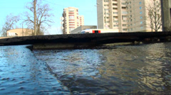 Water flows out from under the asphalt. The accident rupture of the pipeline. - stock footage