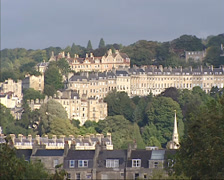 View over terraced houses on hillside, made from the golden-coloured Bath Stone Stock Footage