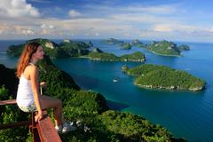 Young woman sitting at the view point, ang thong national marine park, thaila Stock Photos