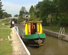 Narrowboat in a lock on the Kennet and Avon canal near Bath Stock Footage