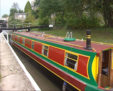 Narrowboat descends in a lock on the Kennet and Avon canal near Bath Stock Footage