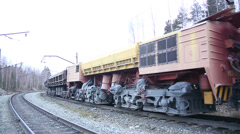 A freight train. The cars. The wheels. Stock Footage