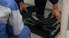 Coach regulates walking trainer. Stock Footage