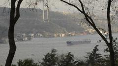 Tanker is crossing Bosporus, Istanbul, Bosporus Bridge, foggy, marine traffic Stock Footage