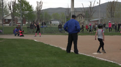Softball game young girls hit and run HD 047 Stock Footage