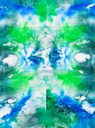 batik - abstract green and blue ornament on silk - stock photo