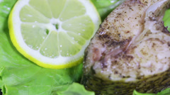 Roasted fish and Fish roe on leaves of lettuce Stock Footage