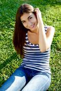 Stock Photo of happy girl in summer in park