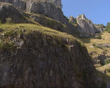 Cheddar Gorge - low angle + pan cliffs and dry limestone soils Stock Footage