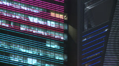 Colours washing across office blocks, track Stock Footage