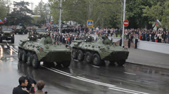 Great parade in Sevastopol. Military cars and people on the square Stock Footage