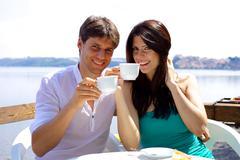 Stock Photo of happy couple having breakfast in vacation in italy