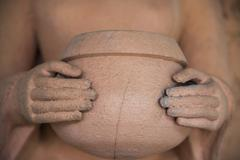Hands hold alms bowl of buddha statue Stock Photos