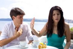 beautiful woman angry with boyfriend not willing to listen - stock photo