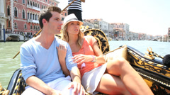 couple in venice having a gondola ride on the canal - stock footage
