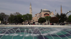 Hagia Sophia Museum in Istanbul, Slow motion seagull is flying on fountain Stock Footage