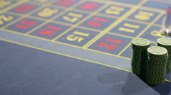 High Angle Sliding CU of Casino Chips piled on the table Stock Footage