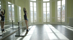 Panning MLS Female Ballet Dancer faces mirroe and practices her movements Stock Footage