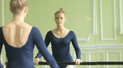 MS Female Ballet Dancer concentrates on arm extension and arabesque Stock Footage