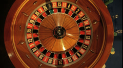 Stock Video Footage of Birdseye MCU of Roulette Wheel Spinning