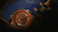 Stock Video Footage of MCU Birdseye Pan of Roulette Table and Players