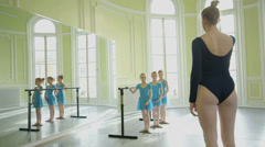 MLS Female Ballet Dancer supervises three younger Ballerinas and teaches them mo Stock Footage