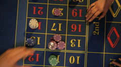 Birdseye CU Player claims her winnings from the Roulette Table  - stock footage