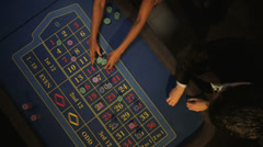 Birdseye Panning CU of Players Gambling in the Casino  Stock Footage