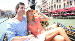Couple in venice having a gondola ride on the canal Stock Footage