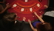 Stock Video Footage of Birdseye Panning CU of Players Gambling in the Casino