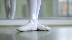 CU A Young Ballerina eases into her soft top Ballet Shoes Stock Footage