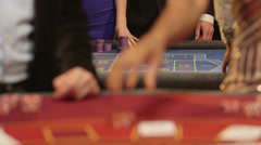Upward Panning MS of Players Gambling in the Casino  Stock Footage