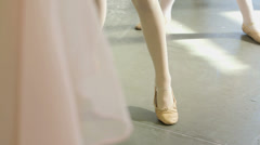 Upward Pan MCU Female Ballet Dancer stands before a trio of Young Ballerinas dem Stock Footage