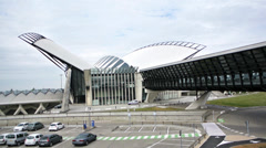 Modern futuristic train station with footbridge in Lyon, France Stock Footage