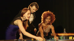 MS A Young and Two Women eagerly celebrate their win at the Casino - stock footage