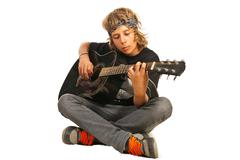 Rocker teen with accoustic guitar - stock photo