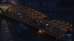 Heavy traffic entering steel frame bridge - stock footage