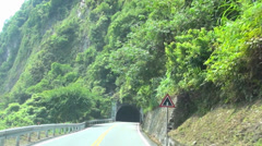 driving on the mountain road and tunnel .time lapse - stock footage