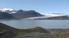 Stock Video Footage of Glacier lower section just by a moraine-dammed lake of meltwater