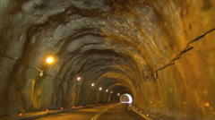 driving through the tunnel of rock. - stock footage