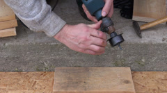 Special drill tool for starling bird house hole Stock Footage