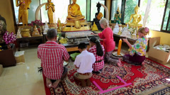 People in Buddhist temple on Pratumnak Hill near Golden Buddha statue in Pattaya Stock Footage