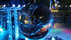 Blue spinning glitterball near dancefloor Stock Footage