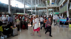 People inside arrival hall in international airport in Bangkok, Thailand Stock Footage